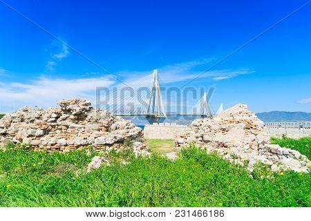 View Of Patras Rion Castle Stone Ruins And Rio Antirrio Bridge, Greece