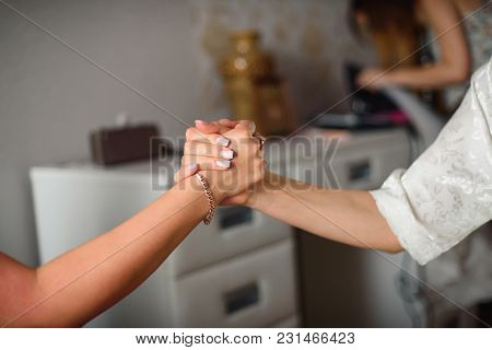 Mother And Daughter Hold Hands Firmly, Preserving Family Values