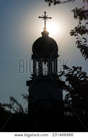 Orthodox Monastery Of St. George. The Bell Tower Above The Sacred Source Of Water Against The Sky An