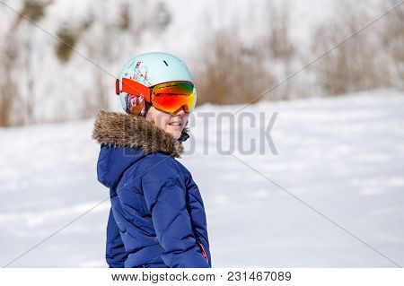 Portrait Of Athlete In Helmet At Winter Day On Blurred Background During Day