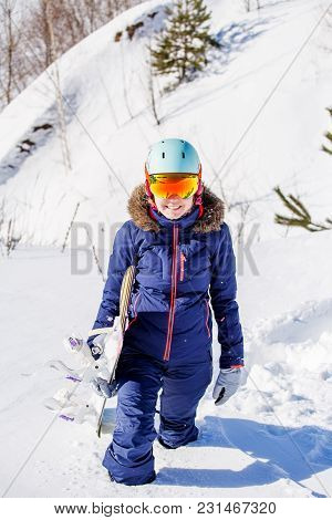 Image Of Female Athlete Wearing Helmet With Snowboard Standing In Winter Park