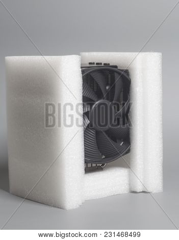 New Computer Fan Processor Cooler With Foam Polystyrene On Gray