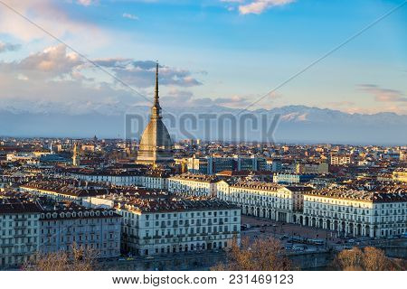 Turin Skyline At Sunset. Torino, Italy, Panorama Cityscape With The Mole Antonelliana Over The City.