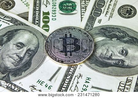 Silver Bitcoins On Us Dollars. Electronic Money Exchange Concept