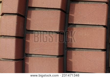 Decorative Relief Brickwork Made Of Reddish Orange Brocks