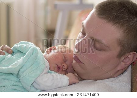 Portrait Of Tired Father, Wich Fell Asleep With His Newborn Baby