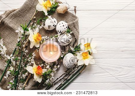 Stylish Easter Flat Lay. Painted Easter Eggs Black And White Colors At Rustic Wooden Background With