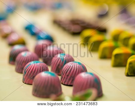 Set Of Colorful Luxury Handmade Bonbons On White Background. Exclusive Handcrafted Chocolate Candies