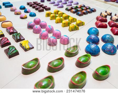 Assortment Of Luxury Handmade Chocolate Candy Collection Isolated On White Background. Set Of Colorf