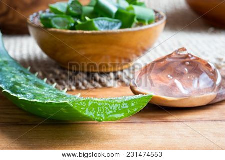 Aloe Vera Leaf, With Aloe Vera Gel And Slices In The Background