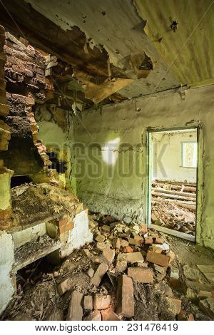 The Ruined Brick Oven Furnace In Abandoned Destroyed Country House In The Zone Of Nuclear Contaminat