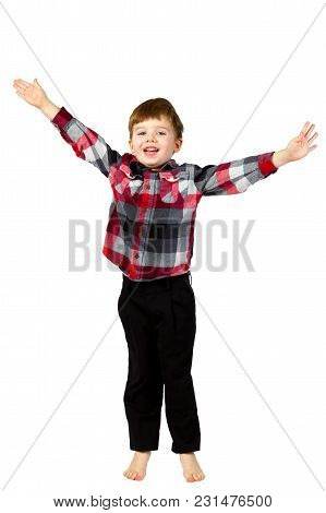 A Cute Little Boy Jumps Up With His Arms Up And Outstretched.  He Looks Welcoming And Excited.  He I