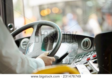 Hands Of Driver In A Modern Bus By Driving.concept - Close-up Of Bus Driver Steering Wheel And Drivi