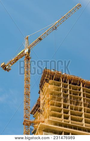New Building, The Construction Of A Modern Multi-storey Building With A Tower Crane And Other Constr