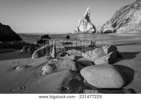 Black And White Photo Of Rocky Coastline Of Atlantic Ocean, Ursa Beach, Portugal