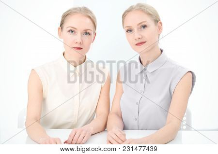 Two Business Ladies Or Colleagues Discussing Something In Office Background. Audit, Tax Or Lawyer Co