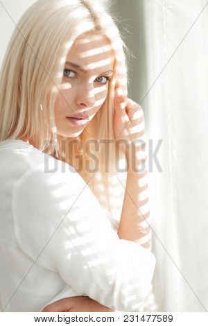 close-up of a young business woman standing near a window