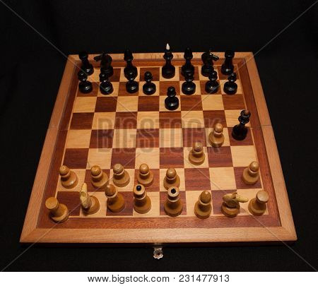 Abstract Composition Of Chess Figures. Isolated On Black Background, Mat In Two Turns.