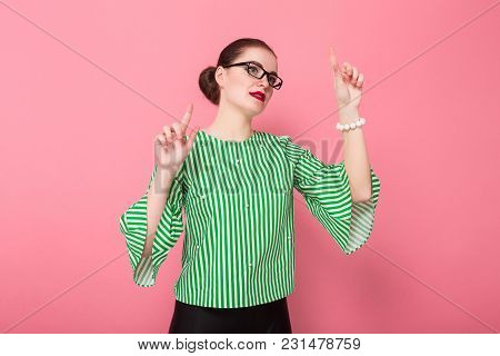 Portrait Of Attractive Businesswoman With Hair Bun In Striped Blouse And Eyeglasses Holding Palms In