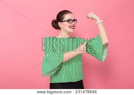 Portrait Of Attractive Scared Businesswoman With Hair Bun In Striped Blouse And Eyeglasses Showing H