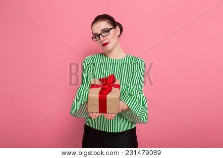 Businesswoman With Hair Bun And Present