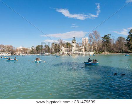 Madrid, Spain - January 27, 2018: People Enjoying A Boat Ride On The Pond In El Retiro Park In Madri