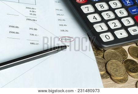 Calculator, Pen, Coins And Accounting Document For Finance And Budget Concept.
