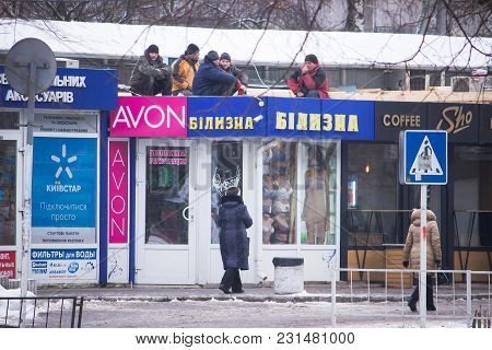 Zhytomyr, Ukraine - January 8, 2018: Lazy Workers Resting On Top Of A New Unfinished Roof Above Shop