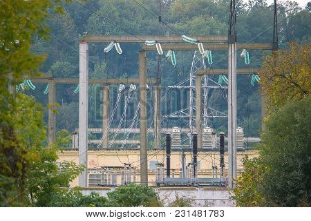 Electric Substation With Transformers In The Forest