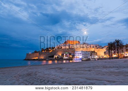 Peniscola, Spain - May 2017: Moonlit Beach In Front Of Peniscola Old Town, Evening View