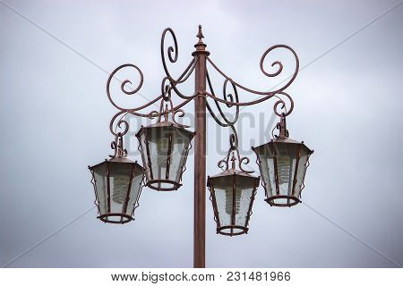 Street Lamppost With Four Lamps On A Gray Background