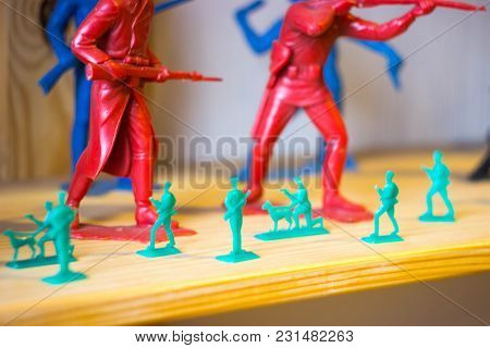 Close Up Image Of Red And Green Toy Military Soldiers At War