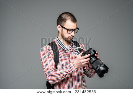 Portrait Of Man Photographer With Professional Camera Isolated On Gray Background