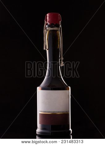 Beautiful Bottle Of Wine With A Red Stopper On A Dark Background Concept Of Alcoholic Drinks
