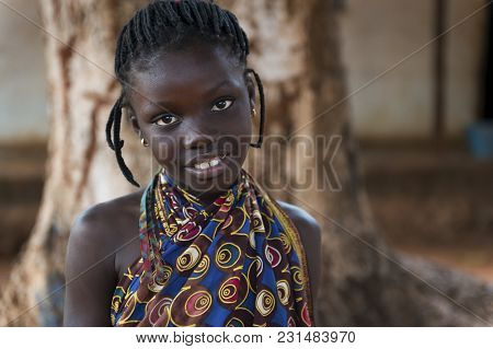 Nhacra, Republic Of Guinea-bissau - January 28, 2018: Portrait Of A Young African Girl Wearing A Col