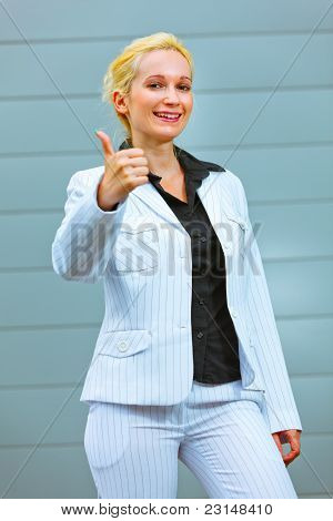 Standing At Office Building Smiling Business Woman Showing Thumbs Up Gesture