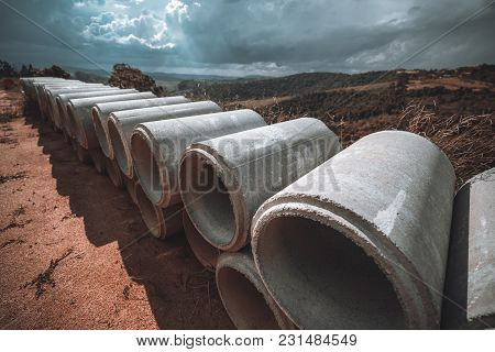 Wide-angle Shot With The Two Rows Of Concrete Or Cement Constructional Pipes Laying One On One, Whic