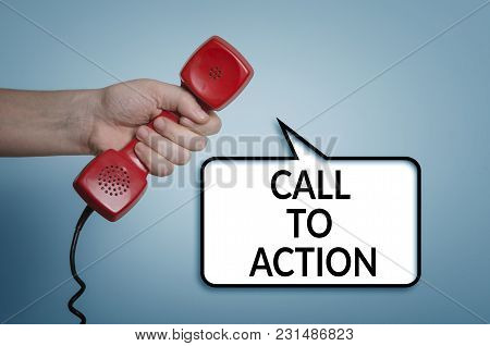 Call To Action Concept With Red Phone In Hand