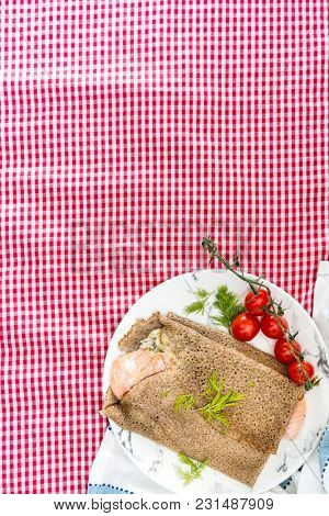 Homemade french salmon buckwheat galette on the table