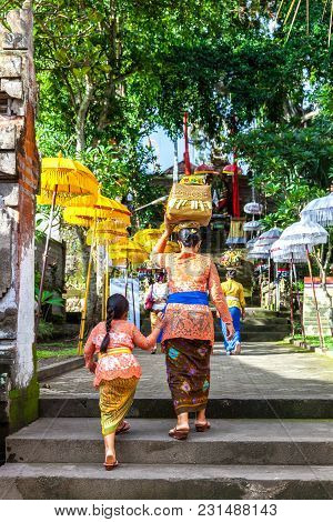 Ubud, Indonesia - March 2: Balinese Woman With Her Daughter In Traditional Clothes During The Celebr