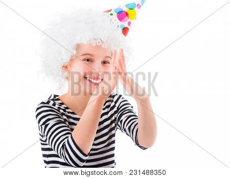 Girl in white curly wig and birthday hat making faces isolated on white background