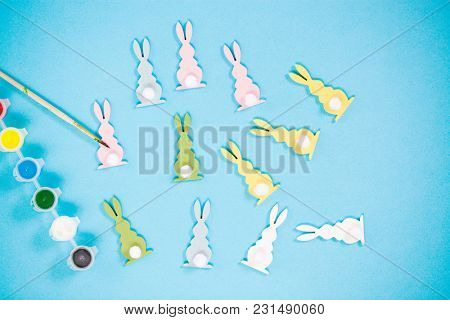 bunny shaped easter decorations on blue background