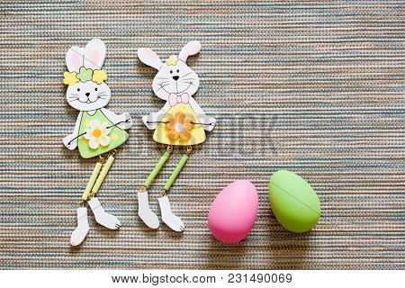 bunny shaped easter decorations and colorful eggs