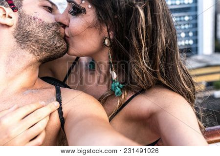 Couple with Carnival Costume Taking a Selfie
