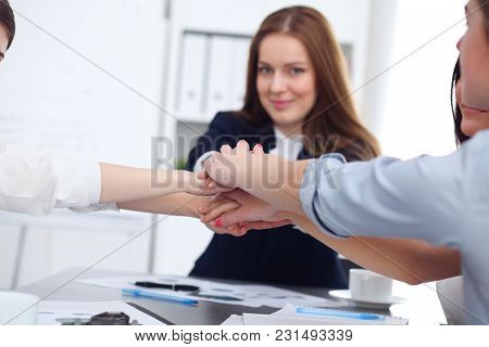 Close Up Of Unknown Business People Joining Hands. Teamwork, Cooperation And Success Concept Of Peop