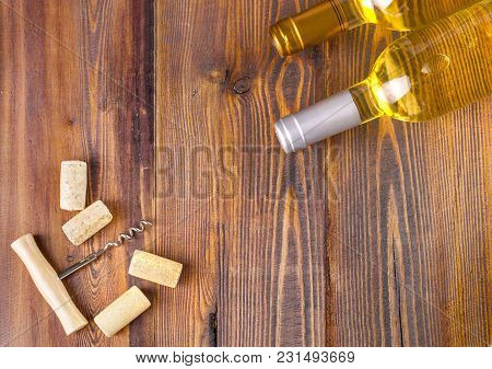 Wine Bottles Collection On Wooden Background, Copy Space, Top View