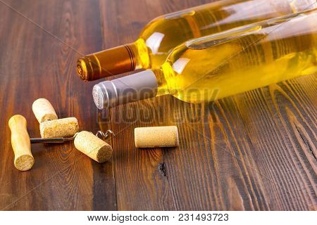 The Wine Bottles Collection On Wooden Background