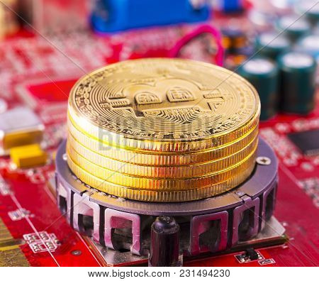 Bitcoin Concept - Gold Coin, Computer Circuit Board With Bitcoin Processor And Microchips. Electroni