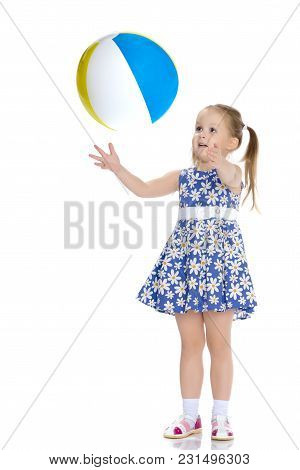 A Nice Little Girl Is Playing With A Big Inflatable Ball. The Concept Of A Happy Childhood, Family R