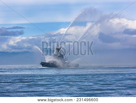 Fire Hose Boat Spraying Water On Kamchatka On Paciic Ocean